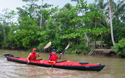 [image] Kayaking on a tributary to the Mekong in the middle of the Mekong delta, from the Bassac