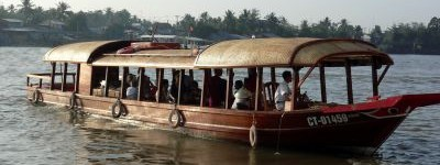 [picture] Mystic sampan departing to one of the Mekong's floating markets with a breakfast buffet