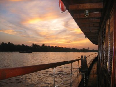 [picture] Sunrise on the river as the Bassac is at an anchor on the Mekong