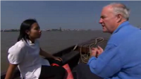 [picture] Ánh and Rick Stein on a longboat, towards fish pens on the Northern Mekong delta