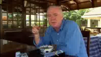 [picture] Rick Stein eating phở on board the Bassac during the filming of his Far Eastern Odyssey